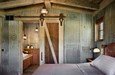 Farmhouse Bedroom with Corrugated Metal Walls | Locati Architects
