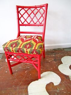 We painted this rattan chair in Benjamin Moore's 'Lady Bug' red for a client. We reupholstered the cushion in an Ikat print by Oscar de la Renta.