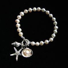 Sea Charms Bracelet with freshwater pearls and hand cast sterling silver shells. See www.wendypenrosejewellery.co.uk for more of Wendy's work
