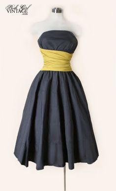 1950's grey and yellow strapless dress at Posh Girl Vintage. Looove the yellow sash!