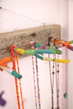 necklace organizer made from twigs;