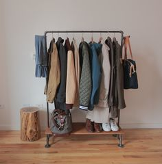 """DIY Coat Rack - would be great for an apartment that is short on closet space - 1/2"""" black steel pipes, 1"""" x 8"""" oak for shelf"""