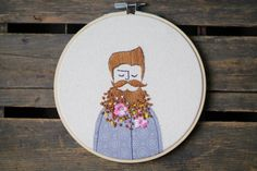 Embroidery Hoop Art, Illustration of a Hipster Guys, Flowers in Beard#embroidery #embroideryhoopart #hoopart #embroideryillustration #illustration #textileart #bohoart #hipsterart #hipster #boho #modernembroiedery #homedecor #customembroidery #embroideryabstractportrait #portraits #kidroomdecor #abstractembroidery #abstractportrait #beard #flowersinbeard #flowersinhair #matryoshka