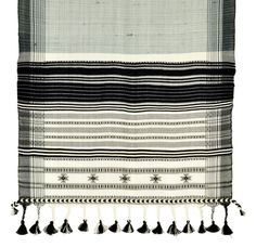 Kutch Weaving, The specialty of the Kutch weaving tradition is the hand insertion of ornamental supplementary wefts, almost like embroidery. In looking at this detailed image, you can see these patterns inlaid into the handwoven plain weave cloth.  Traditionally, blankets (dhablo) incorporated this style of weaving. They were woven with sheep's wool of natural black and white and made for the nomadic Rabaris.