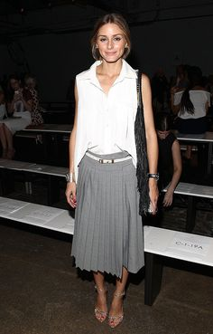 Olivia sported pleated separates — gray tailored Tibi culottes and a crisp white blouse — at the Tibi Spring 2015 show.