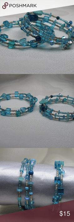 "2 Aqua blue glass beaded memory wire bracelets 2 Aqua blue glass beaded memory wire bracelets.  - Bracelet 1: cube and polygon-shaped aqua blue clear glass beads with smaller silver seed beads - Bracelet 2: multiple shapes and shades of aqua blue beads with silver and blue seed beads  Memory wire is a steel wire that ""remembers"" its shape. Items made with this material do not require a clasp; they will ""snap"" gently closed around the wearer. SparklieFiend Jewelry Bracelets"