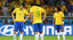 BELO HORIZONTE, BRAZIL - JULY 08: Oscar and Fred of Brazil look dejected as they prepare to kick off after allowing a goal during the 2014 FIFA World Cup Brazil Semi Final match between Brazil and Germany at Estadio Mineirao on July 8, 2014 in Belo Horizonte, Brazil... http://1502983.talkfusion.com/products/