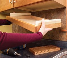 3 Kitchen Storage Projects Squeeze more space from your cabinets with customized roll-outs. by Eric Smith and David Radke It's time to increase the storage space in your kitchen by accessing its u Kitchen Organization, Kitchen Storage, Storage Spaces, Storage Ideas, Cookbook Storage, Kitchen Redo, Kitchen Pantry, Kitchen Ideas, Under Sink Storage