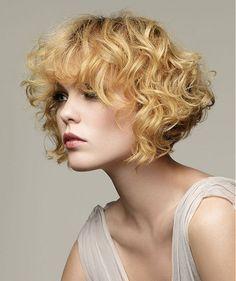 A medium blonde curly wavy bob hairstyle by Revlon Professional