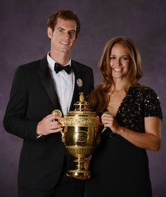 British tennis player Andy Murray poses with the 2013 Wimbledon trophy along with his fiancee Kim Sears during the Wimbledon Champions Dinner in July 2013, a day after he won the men's singles final match.