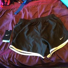 Black dri-fit Nike running shorts The shorts have never been worn but the tag accidentally broke off but I still have it as seen in the picture! Nike Other