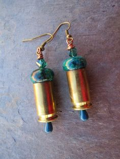 """These earrings are made from repurposed bullet shells/casings. They are made with 45 Blazer shells with a natural blue/green stone, crystal and copper. The earrings hang 2"""" from the copper ear wire."""
