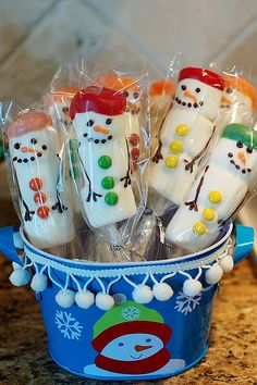 Put three large marshmallows on a sucker stick, dip in white chocolate and decorate with mini M's and icing - super cute!