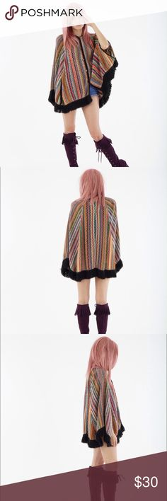 V I N T A G E rainbow fringe poncho Vintage 1970s rainbow knit poncho with fringe hem, button up front, & arm hole openings in front. Fair vintage condition; there are a row of a few holes in back & some pilling on fabric. No size marked; fits multiple sizes. Vintage Sweaters Shrugs & Ponchos