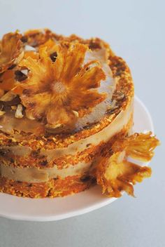 This raw vegan carrot cake has a maple cashew cream frosting.
