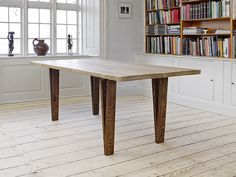 Table made from oak tree whit butterfly.