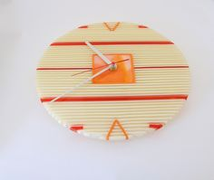 Fused glass on-edge clock in ivory-red-orange. On-edge Strip Construction. by RamizGlass on Etsy https://www.etsy.com/listing/187293208/fused-glass-on-edge-clock-in-ivory-red