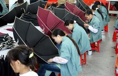 Chinese workers make umbrellas at a factory in Jinjiang, southeastern China's Fujian province