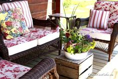 Summer colors on front porch- cushions, pillows, and an enamel pot full of colorful annuals: http://www.front-porch-ideas-and-more.com/summer-decorating-ideas.html