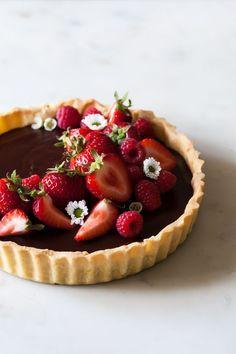 classic chocolate tart with buttery crust, raspberries, and strawberries...YUM