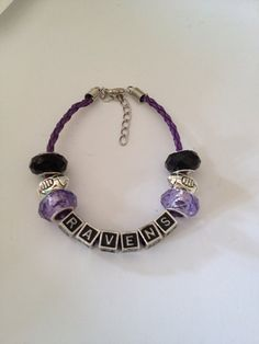 "Baltimore Ravens Football Inspired Beaded Purple Leather Adjustable Bracelet with Silvertone Football Beads 7""-9"""