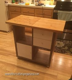 Does your kitchen desperately need more counter and storage space? Here is how to make your own easy DIY rolling Ikea kitchen island! And you can do it in an afternoon! I wanted a rolling island with extra storage, but one that was small enough to fit in my long L-shaped kitchen. I couldn't find a pre-made one that I liked so I designed my own custom one! I wanted drawers and hidden storage, as well as open shelves in the island. The base is a (aff. link) Kallax shelf unit. We adde Kitchen Island Makeover, Diy Kitchen Island, Ikea Kitchen, Kitchen Storage, Ikea Toy Storage, Storage Spaces, Hidden Storage, Extra Storage, Ikea Kallax Shelving