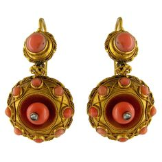 Victorian Etruscan Style Coral Diamond Gold Drop Earrings. A pair of 18ct yellow gold and coral earrings set to the centre with a small diamond and handmade in the Etruscan style around 1870.