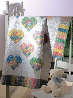 "Create a scrappy look with lots of love using 1930's reproduction prints! Quilt measures 44 1/8"" x 55 1/2""."