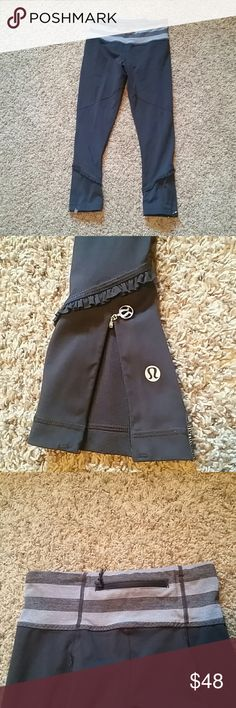 lululemon athletica size 4 cropped pants Lululemon athletica size 4 black cropped pants. Waistband is charcoal gray and light gray striped. Bottoms contains ruffles as well as zippers to make them larger in size at calf area. Pilling between legs as shown.  Reasonable offers welcomed! lululemon athletica Pants Leggings