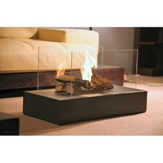 @Overstock - Arrange a set of five faux ceramic logs around this contemporary ventless ethanol fireplace and enjoy the magic of smokeless real fire. This fireplace is fueled by liquid bio-ethanol and emits no smoke, soot or odor.http://www.overstock.com/Home-Garden/Free-Standing-Portable-Bio-ethanol-Fuel-Fireplace/5688727/product.html?CID=214117 $289.79