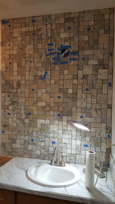 This wall is now covered with silver tumbled Travertine from Lowes. The cost was about $150 for the Travertine, Of course, there is also thinset and grout required, and caulk.