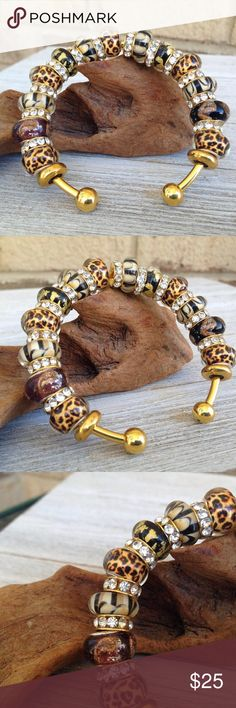 """Animal Print Cuff Bracelet ● The ball ends can be twisted on and off. You can create your own design by adding or removing beads and charms of your choosing.  ● The bracelet will fit beads from most other large hole bead brands.  ● They are completely adjustable! By gently pulling and pushing the ends you can make the cuff fit to your own specifications. The bracelet itself is 2.5"""" in diameter which translates to 7.9"""" for a relatively average to large size wrist and can tighten to 6"""" Colby…"""