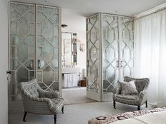 these mirroed doors are wayyyy over the top, but i love it.. Photographer: Joakim Blockström.