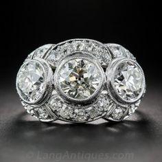 3.65 Carat Diamond and Platinum Art Deco Three-Stone Ring