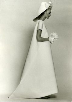 Balenciaga's dramatic wedding dress of white silk-satin and silk gazar, summer, 1968, shown on the eve of the Paris student riots, is austere in its simplicity. Description from genevaanderson.wordpress.com. I searched for this on bing.com/images