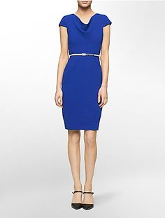 cap sleeves and a cowl neck with lightly padded shoulder detail this slimming dress.