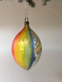 An olive shaped silvered Christmas ornament in a rainbow of colors paired with white stripes. Silver Christmas, Christmas Bulbs, Color Pairing, Glass Ornaments, Glass Art, German, Stripes, Rainbow, Holiday Decor