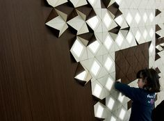 Francesca Rogers in collaboration with Daniele Gualeni created gorgeous wall panels that can be flipped to reveal light spots.