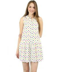 When in doubt wear polka dots! White flowy dress featuring an all over polka dot print.