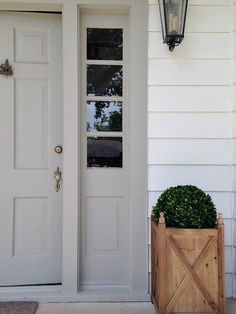 Exterior Paint Colors that Increase Curb Appeal   Siding is SW Pure White and Door Color is SW Dorian Gray.