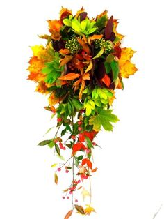 A semi-wired bridal teardrop bouquet made simply using Autumn leaves, capturing the essence and beauty of the season. Would suit a serious nature bunny! Made in the UK by www.sophietownsend.com