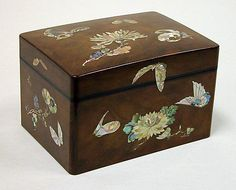 Box  Date: 19th century Culture: Japan Medium: Wood with mother-of-pearl Dimensions: H. 5 1/2 in. (14 cm); W. 5 7/8 in. (14.9 cm); L. 8 3/8 in. (21.3 cm) Classification: Lacquer