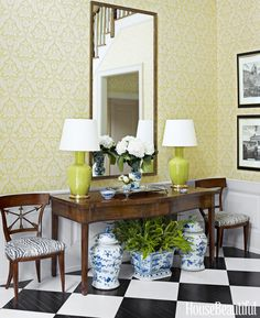 Updating the floor with a custom-painted checkerboard dramatically changed the entryway's personality.