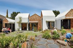 """Appearing """"more medieval village than inner-city extension,"""" a collection of timber shingle-clad towers by Andrew Maynard Architects have been added to the site of an existing mid-century bungalow."""