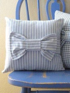 I think I might take some scissors to all the striped dress shirts in the hubby's closet...Blue and White Striped Bow Pillow from Upcycled by stevieb123, $24.00