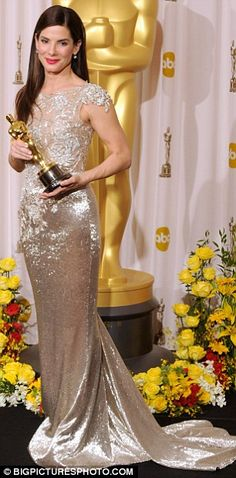 "Sandra Bullock - wearing Marchesa  winning an Oscar for ""Blind Side"" 2010."