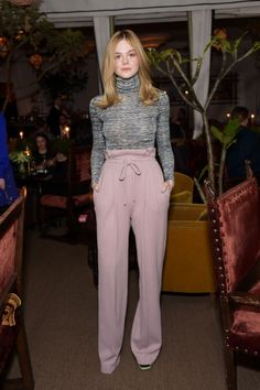 Elle Fanning striking a '70s vibe at an event at the Chateau Marmont in L.A.. See all of the actress's best looks.