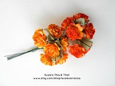 12 Paper Roses On Green Wire Stems, 6 Orange & 6 Goldenrod. Flowers measure about 1 1/4 inches. Susie's This & That on Etsy.