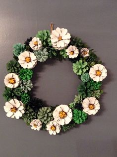 Pine cones are hand painted to offer a variety of colors. Dimensions of wreath are 13.5 x 13.5. Wreath is not recommended for indoor use only.