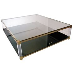 Oversized Brass & Lucite Coffee Table    1970's  Brass and lucite with smoked mirrored plate on bottom